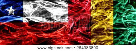 Chile, Chilean Vs Guinea, Guinean Smoke Flags Placed Side By Side. Concept And Idea Flags Mix