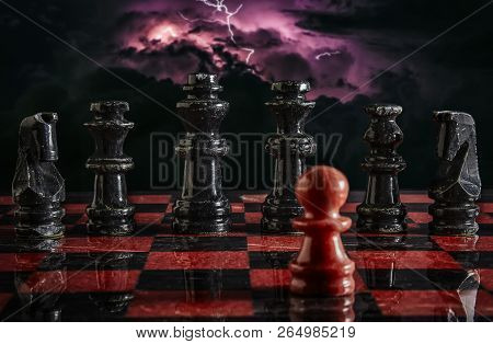 A Metaphorical Image Of A Chessboard With Only One Pawn Against The Entire Enemy Lineup, Symbolizing