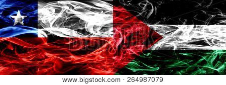 Chile, Chilean Vs Palestine, Palestinian Smoke Flags Placed Side By Side. Concept And Idea Flags Mix