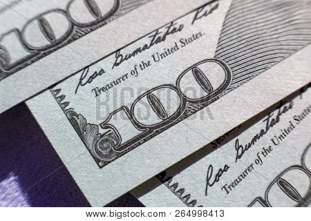 Close-up view on one hundred dollar bill. Macro view on one hundred dollar banknote