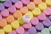 Colorful candy Valentine hearts with MISS YOU showing. poster