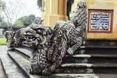 Dragon-shaped handrail in Hue Imperial Palace, Vietnam. The symbol of good fortune on the wall poster