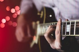 Solo Guitarist Plays The Part On The Electric Guitar. Close-up