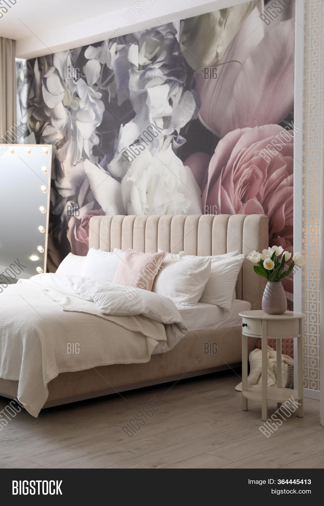 Beautiful Room Interior With Large Bed, Mirror And Floral Pattern On Wall