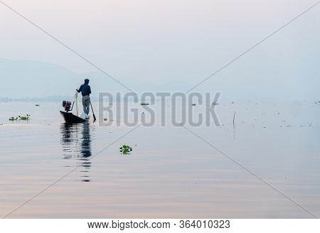 Nyaungshwe, Myanmar : March 12, 2020 - Fisherman Fishes With Net Inle Lake At Sunrise.
