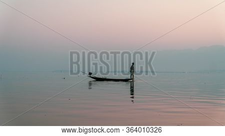 Nyaungshwe, Myanmar : March 12, 2020 - Fisherman Fishes With Net Inle Lake, Second Largest, At Sunri