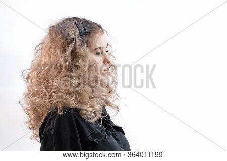 Blonde Girl With Long And Volume Shiny Wavy Hair. Beautiful Model Woman With Curly Hairstyle.