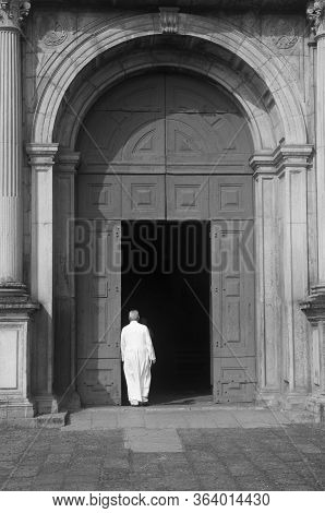 Captured The Priest Entering The Church, As If He Was Entering The Door To Divinity.