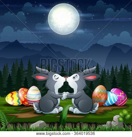 Happy Bunnies Kissing With Easter Eggs In Easter Eve