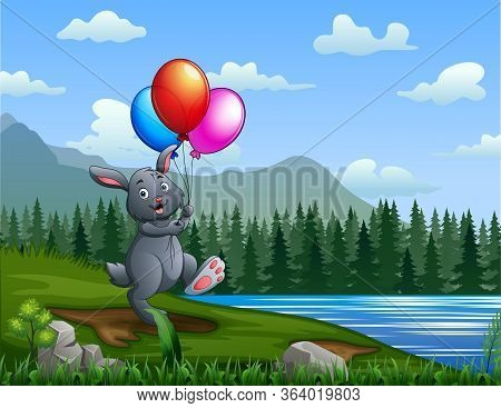 Happy Bunny Holding A Colorful Balloons By The River