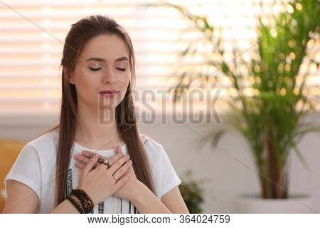 Young Woman During Self-healing Session In Therapy Room