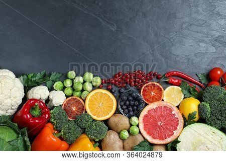 Different Products Rich In Vitamin C On Black Table. Space For Text