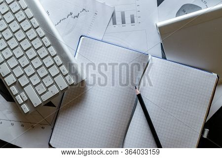 Reviewing Data Financial Diagrams And Graphs In Office. Finance Analysis Background. Planner And Age