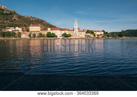 Duernstein Cityscape With Blue And White Baroque Abbey Church Tower, Located On The River Danube In