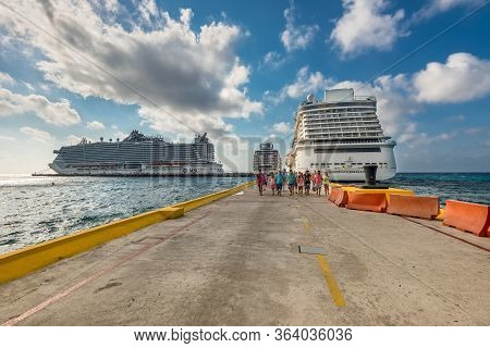 Costa Maya, Mexico - April 25, 2019: Three Cruise Ships Side By Side With Passengers Going To The Cr