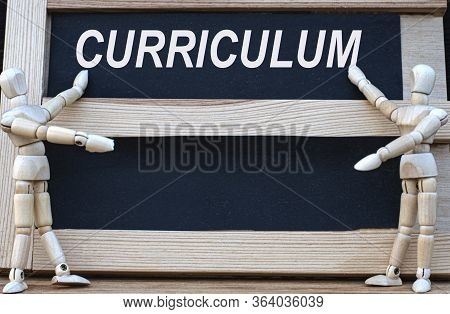 Curriculum Word Written On A Black Board. Nearby Are Two Wooden Men. Business Concept.
