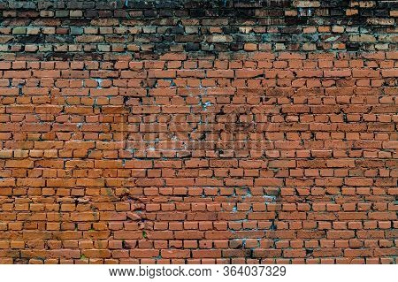 Background With An Old Crumbling Brick Wall.