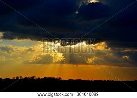 Crepuscular Rays Or Sun Beams Over The Dutch Countryside On A Spring Evening