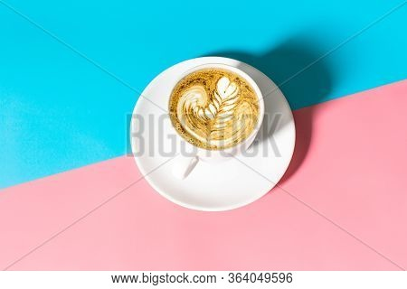 Close Up White Coffee Cup With On Blue And Pink Background, White Cup Of Black Coffee Isolated On Bl