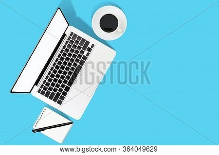 Flat Lay Office Desk Table Of Modern Workplace With Laptop On Blue And Pimk Background, Top View Lap