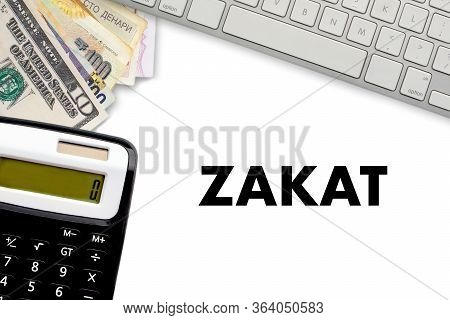 Zakat (islamic Tax)  Text With Keyboard, Multi Banknote Or Currency And Calculator On White Backgrou