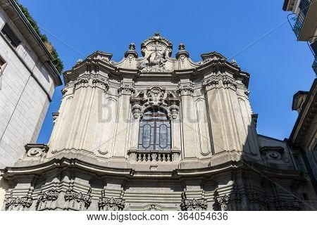 Ornate Facade Of A Church In The City Of Milan, Italy