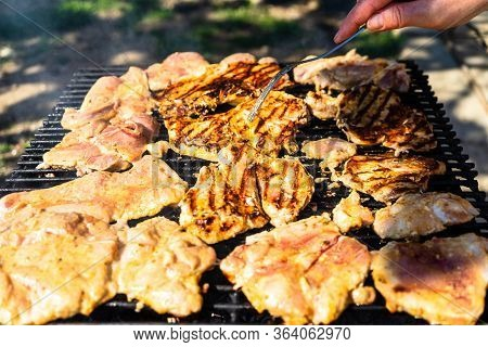 Raw Steak On A Charcoal Barbeque. Top View Of Camping Tasty Barbecue, Food Concept, Food On Grill An