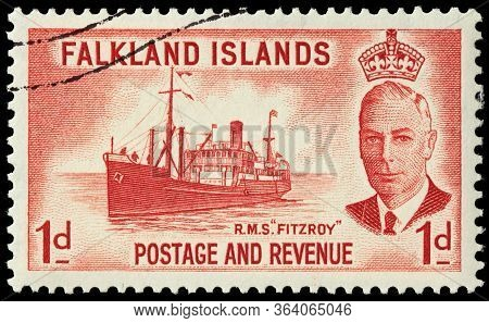 Luga, Russia - October 20, 2019: A Stamp Printed By Falkland Islands  Shows Image Portrait Of King G
