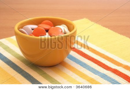 Colorful Candy In Yellow Bowl