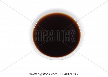 In A White Plate Or Bowl, Brown Dark Unagi Sauce, For Sushi, On An Isolated White Background