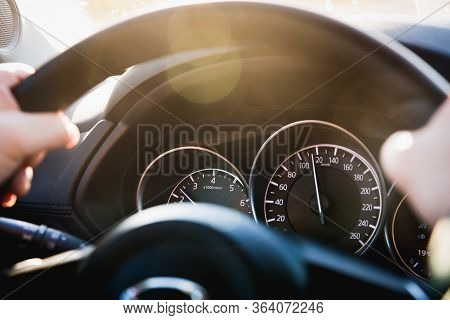 Speedometer Of A Car Close-up, With The Arrow Frozen At A Speed Of 120 Km/h. Details And Interior Of