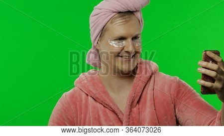 Portrait Of Young Transsexual Man Wearing Pink Bathrobe And Eye Patches After Shower Doing Beauty Pr