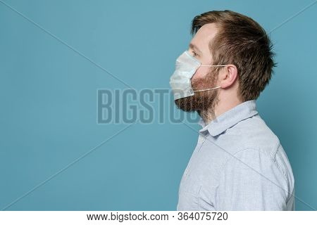 Man With A Shaggy Beard Because Of Which The Medical Mask Does Not Fit Snugly And Does Not Create Fu