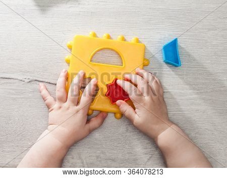 Closeup: Hands Of A Little Montessori Kid Learning About Size, Orders, Sorting, Arranging By Engaged