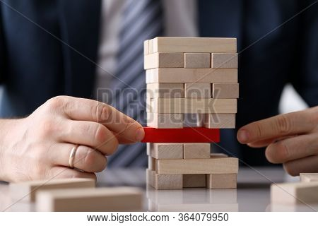 Man Is Trying To Hold Structure Made Wooden Blocks. Flexible System Helps More Productive And Increa