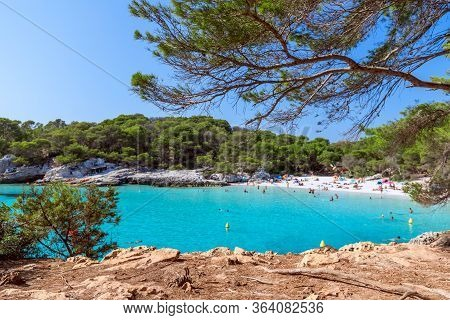 View Of The Famous Beach Cala Turqueta. (focus On Foreground, People On The Beach In Blur). Menorca,