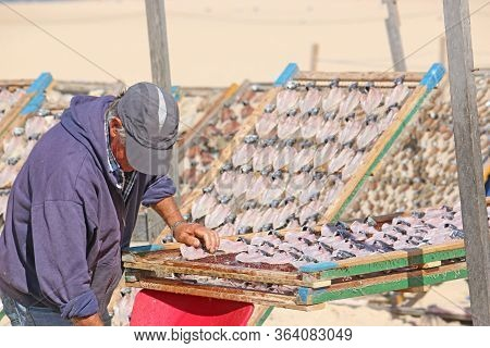 Drying Fish On Nazare Beach In Portugal