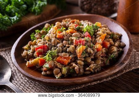 A Bowl Of Delicious Homemade Mediterranean Lentil Salad With Lentils, Peppers, Sun Dried Tomato And