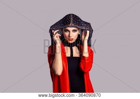 Beautiful Shy Muslim Woman Covering Face With Fashion Veil Isolated On Purple Grey Gray Background.
