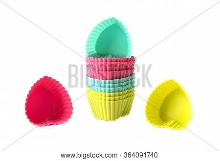 Multi-colored Silicone Cake Baking Dishes Isolated On A White Background. Silicone Baking Dishes In