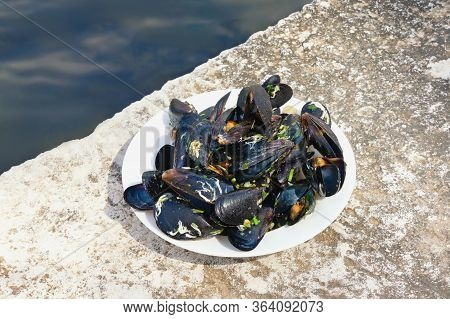 Balkan Cuisine. Dish With Mussels On The Seashore. Montenegro