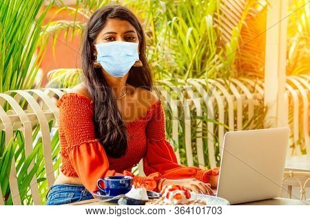 Modern India Woman Working On Laptop In Coffee Shop Eating Pancakes.online Purchase Black Friday Sal