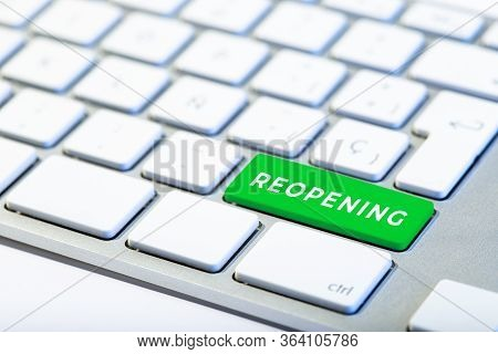 Reopening Concept After The Coronavirus Pandemic. Keyboard With Green Key And Text