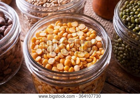 Yellow Split Peas In A Glass Storage Container.