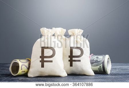 Russian Ruble Money Bags And Cash. Capital Investment. Economics, Lending Business. Profit Income, D