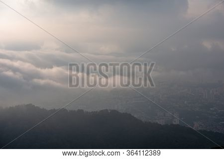 Sea Cloud Cover Georgetown In Hazy Morning. View From Penang Hill.