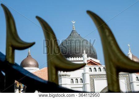 Architecture Masjid Kapitan Keling In Blue Sunny Day.