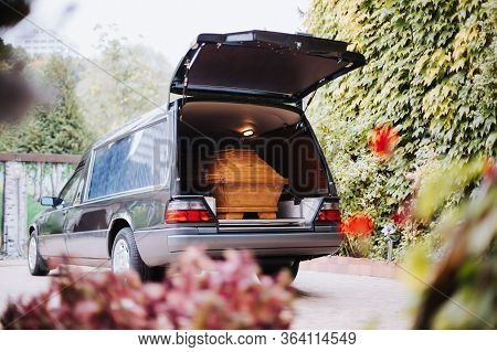 A Coffin In The Back Of A Car At A Funeral