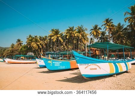 Canacona, Goa, India - February 16, 2020: Sightseeing Tourist Boats Parked On Famous Palolem Beach I