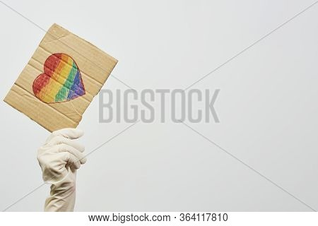Lgbtq Friendly Healthcare System Worker Holding Handmade Placard With Heart-shaped Rainbow Flag. Lgb